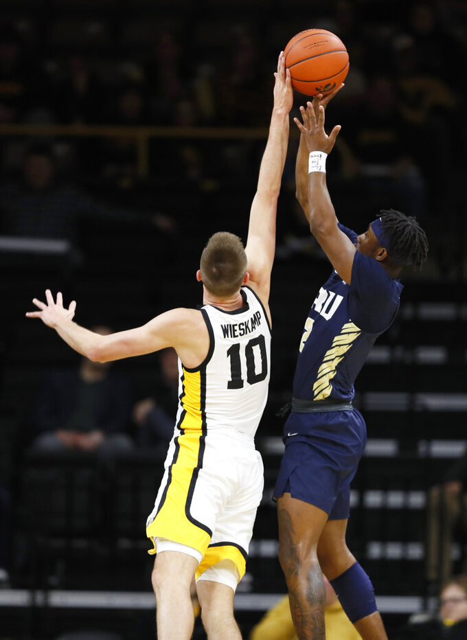 Iowa guard Joe Wieskamp (10) blocks a shot by Oral Roberts guard Deondre Burns during the first half of an NCAA college basketball game, Friday, Nov. 15, 2019, in Iowa City, Iowa. (AP Photo/Charlie Neibergall)