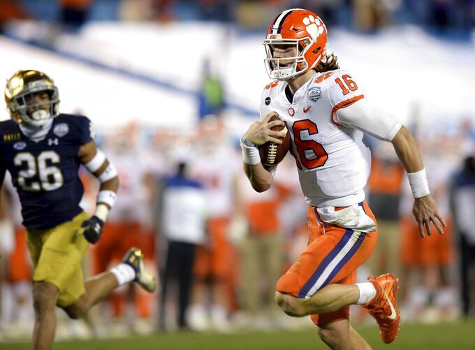 Clemson quarterback Trevor Lawrence rushes for a touchdown against Notre Dame during third-quarter action in the Atlantic Coast Conference championship NCAA college football game, Saturday, Dec. 19, 2020, in Charlotte, N.C. (Jeff Siner/The News & Observer via AP)