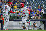 St. Louis Cardinals' Nolan Arenado (28) is congratulated by third base coach Ron 'Pop' Warner (75) after hitting a two-run home run during the first inning of a baseball game against the Milwaukee Brewers, Monday, Sept. 20, 2021, in Milwaukee. (AP Photo/Aaron Gash)