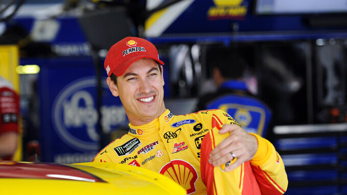 Joey Logano smiles during practice for Sunday's NASCAR Cup Series auto race at Charlotte Motor Speedway in Concord, N.C., Saturday, Sept. 28, 2019. (AP Photo/Mike McCarn)