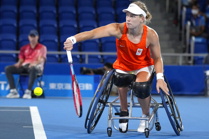 Diede de Groot of the Netherlands returns to Yui Kamiji of Japan during their Wheelchair tennis women's singles final at the Tokyo 2020 Paralympic Games, Friday, Sept. 3, 2021, in Tokyo, Japan. (AP Photo/Shuji Kajiyama)