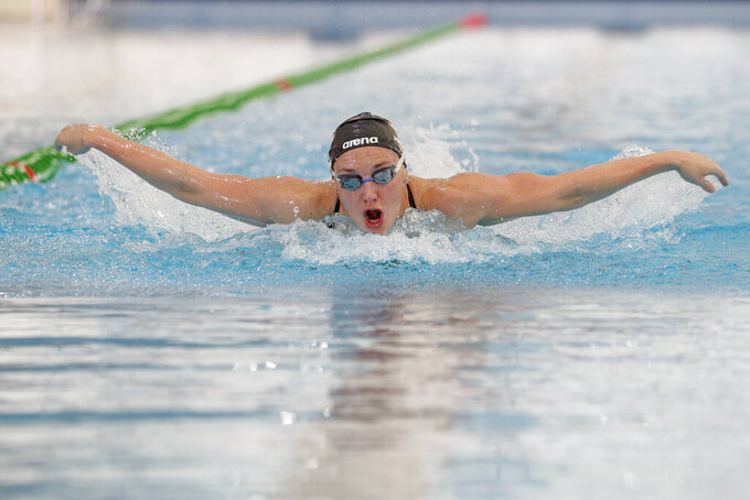 """FILE - In this Feb. 26, 2020, file photo, Hungarian swimmer Katinka Hosszú practices during a training session, in Naples. It's different strokes for different folks in swimming. That makes sense for a sport that will hand out medals in a whopping 35 different pool events at the Tokyo Olympics. Hosszú says the Hungarians' medley success can be attributed to work ethic. She adds that """"we are very stubborn and very much hard-working and we can just grind it out."""" (AP Photo/Andrew Medichini, File)"""