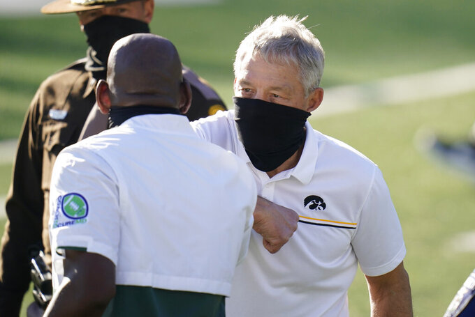 Iowa head coach Kirk Ferentz greets Michigan State head coach Mel Tucker, left, after an NCAA college football game, Saturday, Nov. 7, 2020, in Iowa City, Iowa. Iowa won 49-7. (AP Photo/Charlie Neibergall)