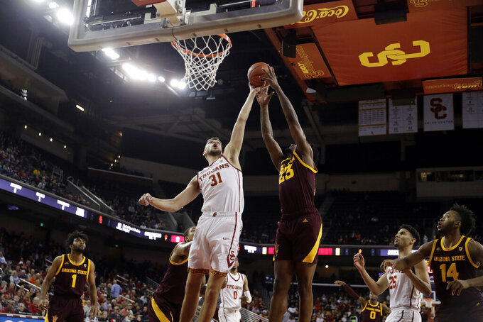 Southern California forward Nick Rakocevic (31) works for a rebound against Arizona State forward Romello White (23) during the first half of an NCAA college basketball game Saturday, Jan. 26, 2019, in Los Angeles. (AP Photo/Marcio Jose Sanchez)