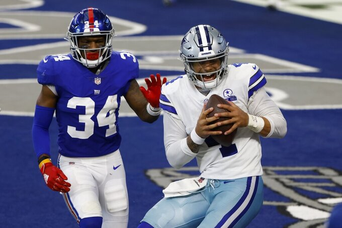 New York Giants safety Adrian Colbert (34) defends as Dallas Cowboys quarterback Dak Prescott (4) catches a pass for a touchdown thrown by wide receiver Cedrick Wilson in the first half of an NFL football game in Arlington, Texas, Sunday, Oct. 11, 2020. (AP Photo/Ron Jenkins)