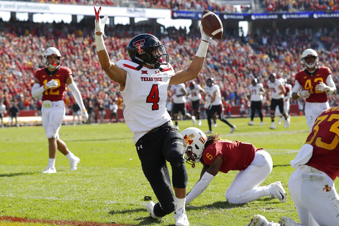 Texas Tech wide receiver Antoine Wesley (4) celebrates in front of Iowa State defensive back De'Monte Ruth (6) after catching a 31-yard touchdown pass during the second half of an NCAA college football game, Saturday, Oct. 27, 2018, in Ames, Iowa. (AP Photo/Charlie Neibergall)
