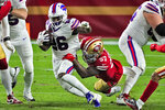 Buffalo Bills running back Devin Singletary (26) is tackled by San Francisco 49ers outside linebacker Dre Greenlaw (57) during the first half of an NFL football game, Monday, Dec. 7, 2020, in Glendale, Ariz. (AP Photo/Rick Scuteri)