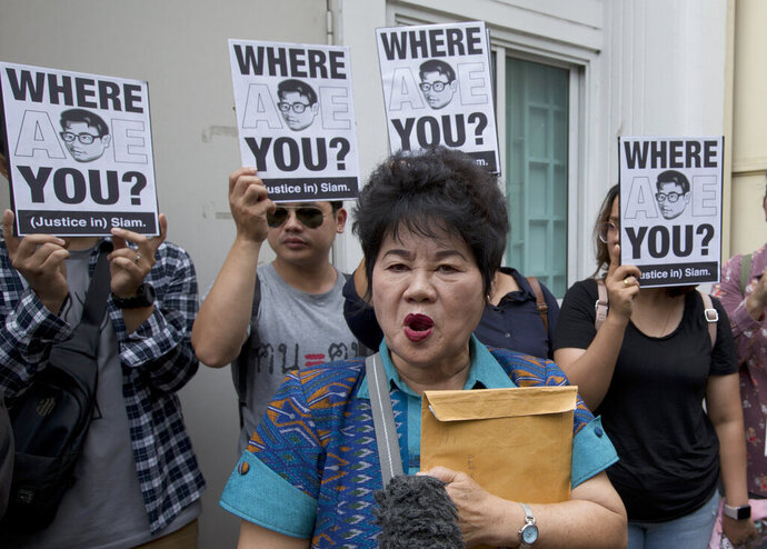 Kanya Theerawut, mother of Siam Theerawut, talks to reporters outside Vietnam Embassy in Bangkok, Thailand, Monday, May 13, 2019. Siam is one of three self-exiled Thai activists who seem to have disappeared after they were reportedly arrested by Vietnamese authorities earlier this year. The three men, Chucheep Chivasut, Siam Theerawut, and Kritsana Thapthai, have been accused by Thai authorities of insulting the country's monarchy including by operating an online anti-monarchy radio programs and mobilizing support for anti-monarchy campaigns. (AP photo/Sakchai Lalit)