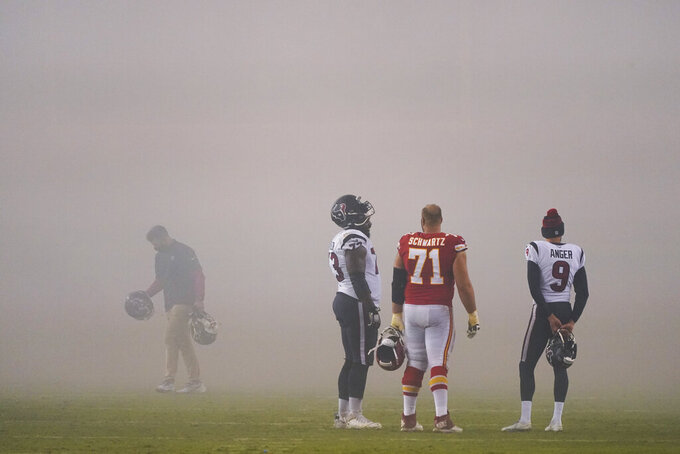Kansas City Chiefs offensive tackle Mitchell Schwartz (71) talks with Houston Texans guard Zach Fulton (73) and punter Bryan Anger (9) after an NFL football game Thursday, Sept. 10, 2020, in Kansas City, Mo. The Chiefs won 34-20. (AP Photo/Charlie Riedel)