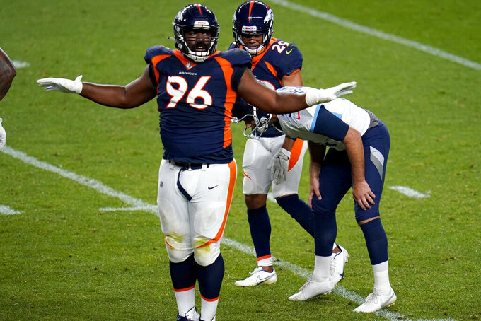 Tennessee Titans kicker Stephen Gostkowski reacts after missing his field goal attempt as Denver Broncos defensive end Shelby Harris (96) signals the miss during the second half of an NFL football game, Monday, Sept. 14, 2020, in Denver. t. (AP Photo/Jack Dempsey)