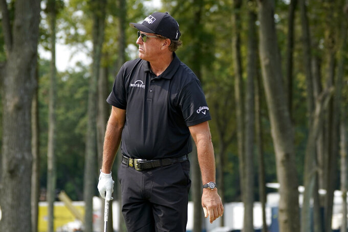Phil Mickelson, of the United States, prepares to putt on the fifth green during a practice round for the US Open Golf Championship, Wednesday, Sept. 16, 2020, in New York. (AP Photo/Charles Krupa)