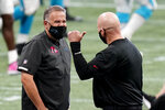 Carolina Panthers head coach Matt Rhule speaks with Atlanta Falcons head coach Dan Quinn at midfield before the first half of an NFL football game, Sunday, Oct. 11, 2020, in Atlanta. (AP Photo/Brynn Anderson)