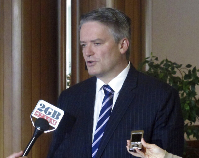 FILE - In this Aug. 8, 2017, file photo, Australian Finance Minister Mathias Cormann addresses reporters at Parliament House in Canberra, Australia. Cormann, one of Prime Minister Scott Morrison's most senior Cabinet members, said Sunday, July 5, 2020 he is retiring from politics at the end of the year. Belgium-born Cormann, who has been finance minister since 2013, entered federal politics in 2007 and became the leader government's Senate, or upper house, leader in 2017. (AP Photo/Rod McGuirk, File)