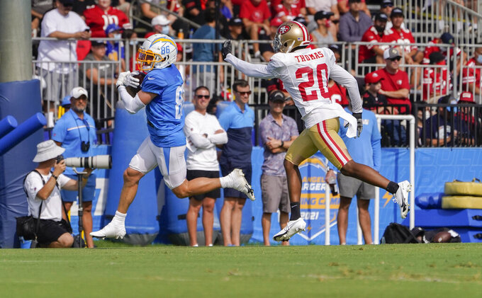 Los Angeles Chargers wide receiver Austin Proehl, left, catches the ball as San Francisco 49ers cornerback Ambry Thomas defends during NFL football practice in Costa Mesa, Calif., Thursday, Aug. 19, 2021. (AP Photo/Damian Dovarganes)