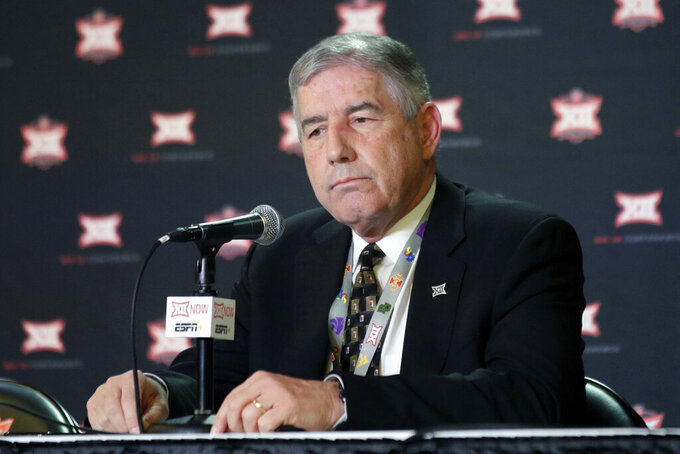 FILE - In this March 11, 2020, file photo, Big 12 Commissioner Bob Bowlsby announces no fans will be admitted to the rest of the Big 12 basketball tournament, in Kansas City, Kan. After the Power Five conference commissioners met Sunday, Aug. 9, 2020, to discuss mounting concern about whether a college football season can be played in a pandemic, players took to social media to urge leaders to let them play. (AP Photo/Orlin Wagner, File)