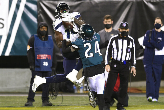 Seattle Seahawks' DK Metcalf (14) catches a pass against Philadelphia Eagles' Darius Slay (24) during the second half of an NFL football game, Monday, Nov. 30, 2020, in Philadelphia. (AP Photo/Derik Hamilton)