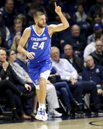 Creighton guard Mitch Ballock (24) recognizes a teammate after making a 3-point shot in the first half of an NCAA college basketball game against Xavier Saturday, Jan. 11, 2020, in Cincinnati. (Kareem Elgazzar/The Cincinnati Enquirer via AP)