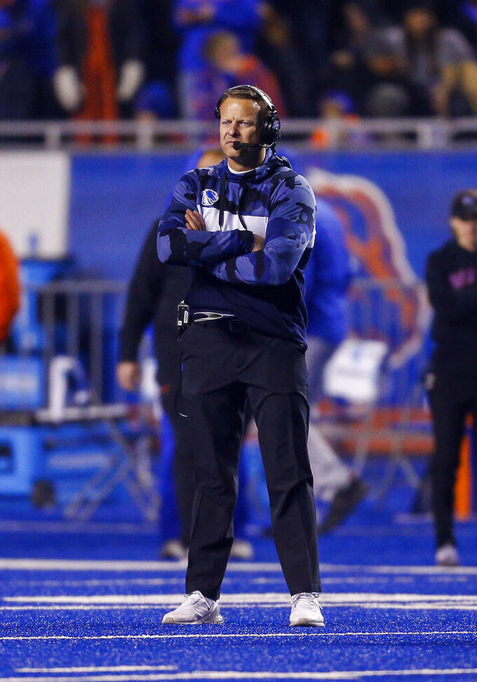 Boise State head coach Bryan Harsin looks on during a timeout against Wyoming during the second half of an NCAA college football game Saturday, Nov. 9, 2019, in Boise, Idaho. Boise State won 20-17. (AP Photo/Steve Conner)