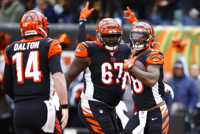 Cincinnati Bengals running back Joe Mixon (28) celebrates his touchdown during the first half of an NFL football game against the New York Jets, Sunday, Dec. 1, 2019, in Cincinnati. (AP Photo/Gary Landers)