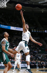 Michigan State's Malik Hall, right, shoots against Eastern Michigan's Jalen King during the second half of an NCAA college basketball game, Saturday, Dec. 21, 2019, in East Lansing, Mich. (AP Photo/Al Goldis)
