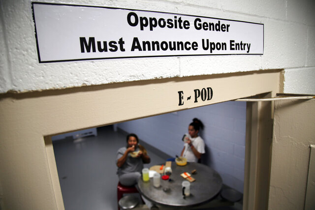 FILE - This June 6, 2019 file photo provided by U.S. Immigration and Customs Enforcement shows one of the signs over the doorways within the dedicated unit for transgender migrants in the Cibola County Correctional Center in Milan, N.M. One month after winning her release from immigration detention, a transgender woman from El Salvador was arrested  Monday, Jan. 13, 2020, and taken back to the Cibola County facility because the U.S. government is appealing. Lawyers say the woman is being unfairly detained and has a seizure disorder that threatens her life if left untreated. (Ron Rogers/U.S. Immigration and Customs Enforcement via AP, File)