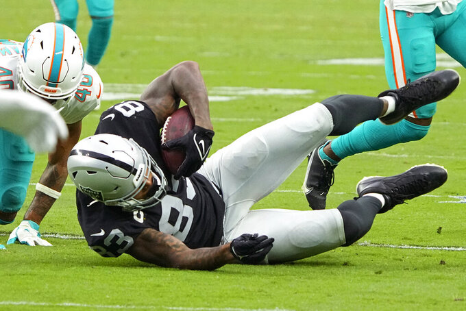 Las Vegas Raiders tight end Darren Waller (83) makes a catch against the Miami Dolphins during the second half of an NFL football game, Sunday, Sept. 26, 2021, in Las Vegas. (AP Photo/Rick Scuteri)