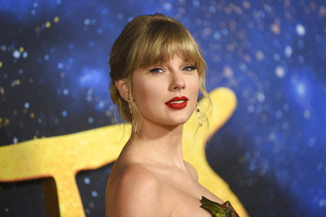 FILE - In a  Monday, Dec. 16, 2019 file photo, Taylor Swift attends the world premiere of