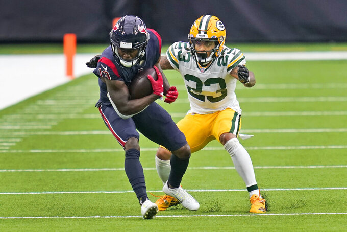 Houston Texans wide receiver Brandin Cooks (13) catches a pass as Green Bay Packers cornerback Jaire Alexander (23) defends during the second half of an NFL football game Sunday, Oct. 25, 2020, in Houston. (AP Photo/Sam Craft)