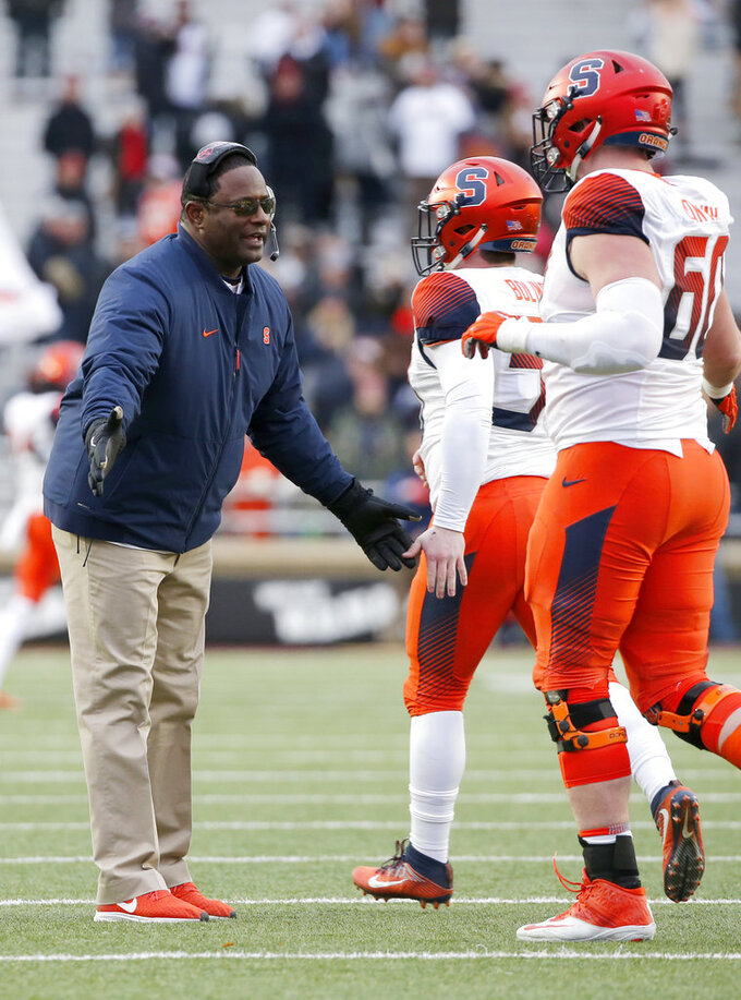 Syracuse head coach Dino Babers congratulates his team after an extra point conversion during the second half of an NCAA college football game against Boston College, Saturday, Nov. 24, 2018, in Boston. (AP Photo/Mary Schwalm)