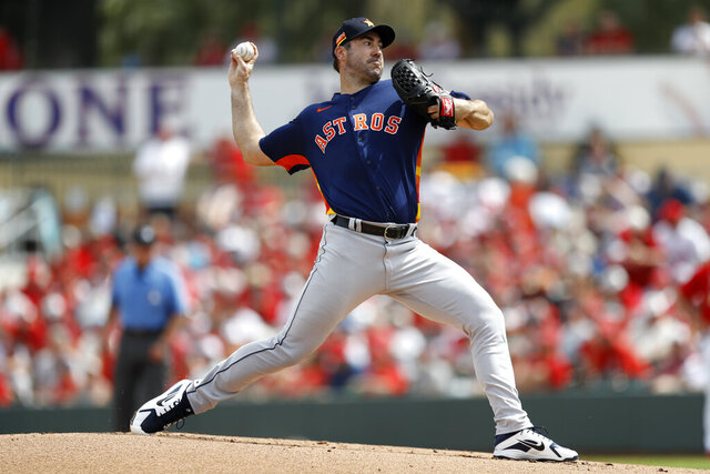 Houston Astros pitcher Justin Verlander throws a pitch during the first inning of a spring training baseball game against the St. Louis Cardinals, Tuesday, March 3, 2020, in Jupiter, Fla. (AP Photo/Julio Cortez)