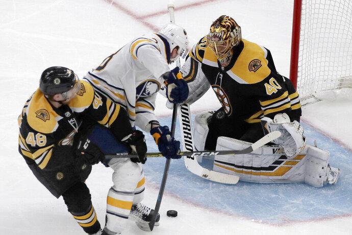 Buffalo Sabres center Zemgus Girgensons (28) can't score against the defense of Boston Bruins defenseman Matt Grzelcyk (48) and goaltender Tuukka Rask (40) during the second period of an NHL hockey game Thursday, Nov. 21, 2019, in Boston. (AP Photo/Elise Amendola)