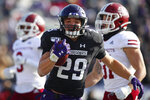 Northwestern's Evan Hull, center, celebrates as he scores a touchdown past Massachusetts' Isaiah Rodgers, left, and Massachusetts' Logan Darby during the first half of an NCAA college football game Saturday, Nov. 16, 2019, in Evanston, Ill. (AP Photo/Jim Young)