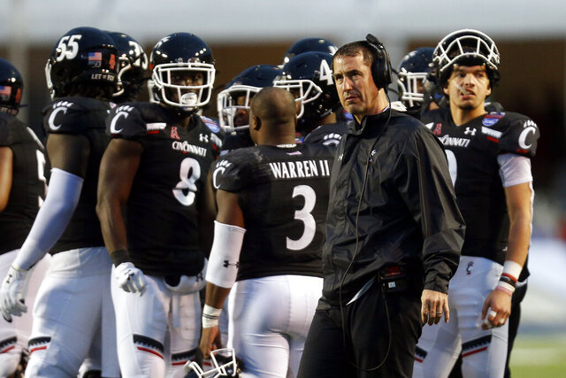 Cincinnati head coach Luke Fickell looks on during a timeout during the first half of the Birmingham Bowl NCAA college football game against Boston College, Thursday, Jan. 2, 2020, in Birmingham, Ala. (AP Photo/Butch Dill)