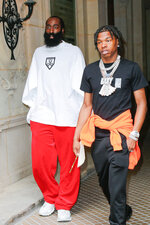 NBA player James Harden, left, and US rap artist Lil' Baby arrive at the Balenciaga Haute Couture Fall-Winter 2021/2022 as part of the Paris Fashion Week, Wednesday, July 7 2021 in Paris. Paris police released rapper Lil Baby from custody on Friday, July 9 after fining him for having cannabis in his car, according to the city prosecutor's office. He was stopped along with NBA star James Harden, who was frisked but not detained. (AP Photo/ J.M Haedrich)