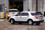 A motorcade of official vehicles arrives at federal court where Robert Bowers is to be arraigned on additional charges, Monday, Feb. 11, 2019, in Pittsburgh. Bowers is accused of killing 11 and wounding seven during an attack on a Pittsburgh synagogue in October of 2018. (AP Photo/Keith Srakocic)