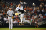 Colorado Rockies shortstop Trevor Story throws to first but is unable to put out Washington Nationals' Lane Thomas who singled during the sixth inning of a baseball game on Friday, Sept. 17, 2021, in Washington. Story was charged with a throwing error on the play which enabled Thomas reach second. (AP Photo/Nick Wass)