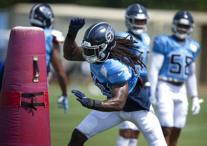 Tennessee Titans outside linebacker Jadeveon Clowney (99) runs through pass rushing drills during an NFL football practice in Nashville, Wednesday, Sept. 9, 2020. (George Walker IV/The Tennessean via AP, Pool)