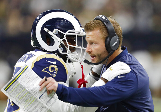 Los Angeles Rams head coach Sean McVay speaks with C.J. Anderson during the first half of the NFL football NFC championship game against the New Orleans Saints, Sunday, Jan. 20, 2019, in New Orleans. (AP Photo/John Bazemore)