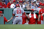 Los Angeles Angels' Matt Thaiss (23) is welcomed to the dugout after scoring on a hit by Shohei Ohtani in the second inning of a baseball game against the Boston Red Sox at Fenway Park, Sunday, Aug. 11, 2019, in Boston. (AP Photo/Steven Senne)