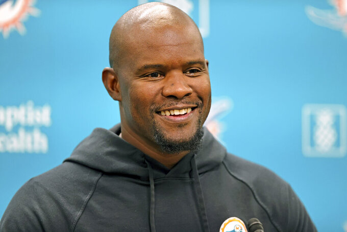 Miami Dolphins head coach Brian Flores talks to the media before an NFL football practice at Baptist Health Training Complex in Hard Rock Stadium on Wednesday, Oct. 6, 2021, in Miami Gardens, Fla. The Dolphins play the Tampa Bay Buccaneers on Sunday in Tampa, Fla. (David Santiago/Miami Herald via AP)