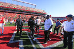 Rutgers interim head coach Nunzio Campanile, center left, shakes hands with Maryland head coach Michael Locksley after an NCAA college football game, Saturday Oct. 5, 2019, in Piscataway, N.J. (Andrew Mills/NJ Advance Media via AP)
