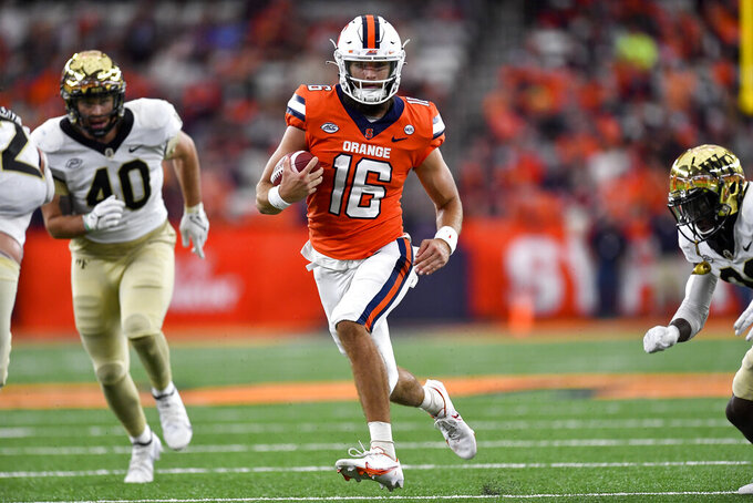 Syracuse quarterback Garrett Shrader (16) runs with the ball during the first half of an NCAA college football game against Wake Forest in Syracuse, N.Y., Saturday, Oct. 9, 2021. (AP Photo/Adrian Kraus)