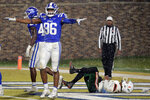 FILE - In this Nov. 30, 2019 file photo, Duke's Chris Rumph II (96) celebrates in front of Miami's Jarren Williams (15) after Duke made a defensive stop during the third quarter of an NCAA college football game in Durham, N.C. Football players and other college athletes are facing challenges when it comes to following nutrition plans amid the coronavirus pandemic. Rumph has been staying with family and eating home-cooked meals as he tries to gain strength amid the pandemic that has shut down college and professional sports. (AP Photo/Chris Seward, File)