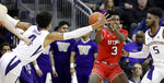 Washington's Matisse Thybulle (4) stretches across to try to stop a pass from Utah's Donnie Tillman (3) as Washington's Jaylen Nowell watches during the first half of an NCAA college basketball game Wednesday, Feb. 20, 2019, in Seattle. (AP Photo/Elaine Thompson)