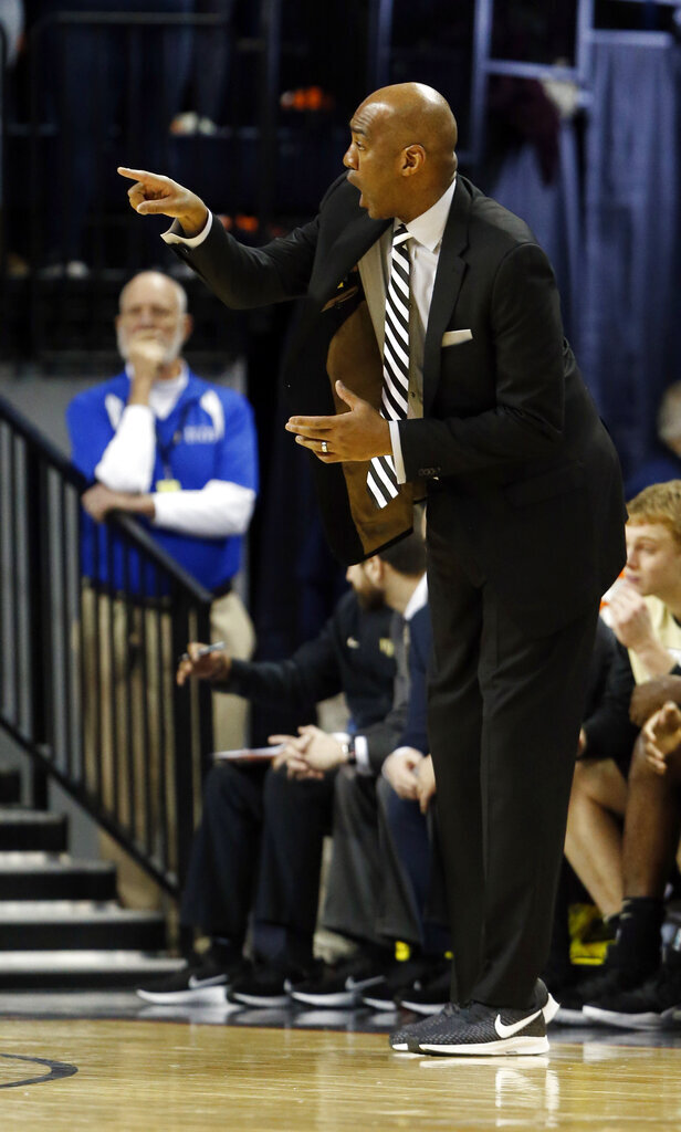Wake Forest head coach Danny Manning directs his team during the first half of an NCAA college basketball game in Charlottesville, Va., Tuesday, Jan. 22, 2019. (AP Photo/Steve Helber)