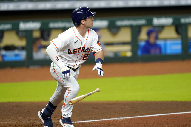 Houston Astros' Alex Bregman watches his two-run single against the Texas Rangers during the seventh inning of a baseball game Tuesday, Sept. 15, 2020, in Houston. (AP Photo/David J. Phillip)