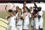 Gonzaga players celebrate after defeating BYU in an NCAA college basketball game for the West Coast Conference men's tournament championship Tuesday, March 9, 2021, in Las Vegas. (AP Photo/David Becker)