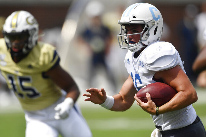 Citadel quarterback Brandon Rainey (16) runs for a touchdown against Georgia Tech during the second half of an NCAA college football game, Saturday, Sept. 14, 2019, in Atlanta. The Citadel won 27-24 in overtime. (AP Photo/Mike Stewart)