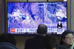 A man watches a TV screen showing an image of a North Korean long-range rocket launch site during a news program at the Seoul Railway Station in Seoul, South Korea, Monday, Dec. 9, 2019. North Korea said Sunday it carried out a