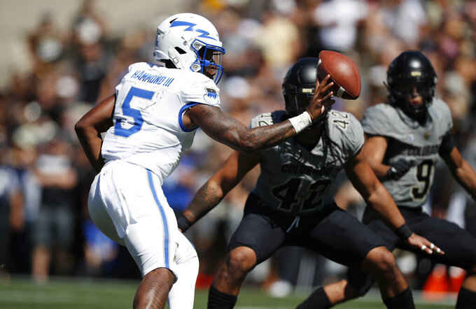 Air Force quarterback Donald Hammond III pitches the ball as Colorado linebacker Nu'umotu Falo Jr. defends in the second half of an NCAA college football game Saturday, Sept. 14, 2019, in Boulder, Colo. Air Force won 30-23 in overtime. (AP Photo/David Zalubowski)